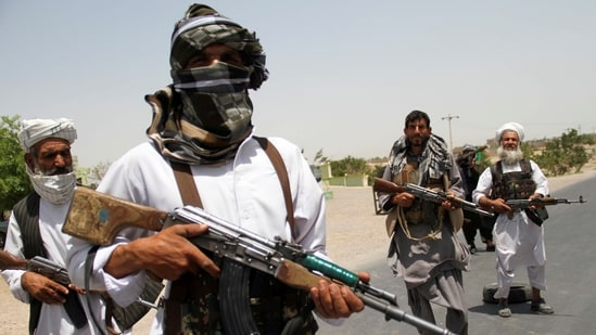 Former Mujahideen hold weapons to support Afghan forces in their fight against Taliban, on the outskirts of Herat province, Afghanistan.(Reuters)