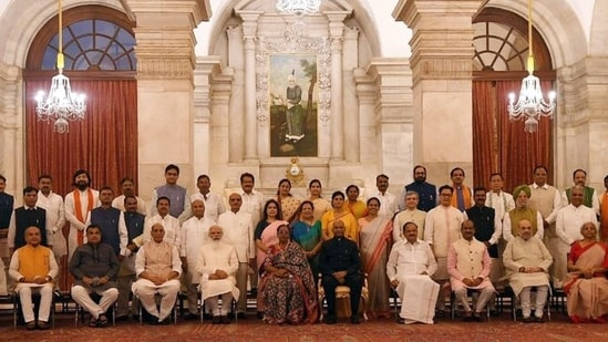 Prime Minister Narendra Modi in a group photograph with ministers during the swearing-in ceremony as part of Union cabinet expansion at Rashtrapati Bhawan in New Delhi on Wednesday.