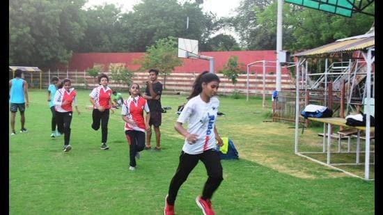 Sportspersons practicing at Madam Mohan Malviya Stadium of Prayagraj. (Anil Kumar Maurya/HTphoto)