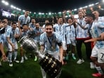 Argentina's Lionel Messi celebrates with the trophy after beating Brazil 1-0 in the Copa America final(AP)