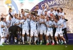 Lionel Messi and the Argentine team celebrates with the Copa America trophy after their 1-0 win over Brazil in the final at the Maracana Stadium in Rio de Janeiro.(Getty Images)