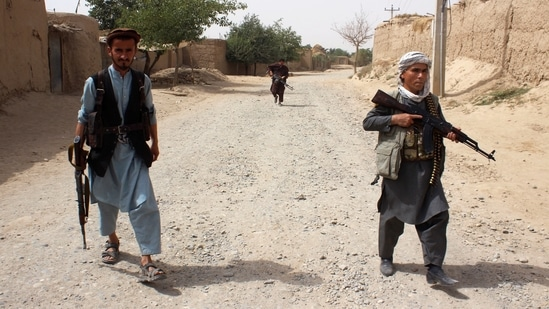 Armed Afghan militias patrol on the outskirts of Takhar province, Afghanistan.(REUTERS)