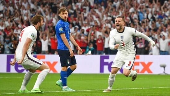 England's Luke Shaw, right, celebrates after scoring his side's opening goal during the Euro 2020 final match between England and Italy.(AP)