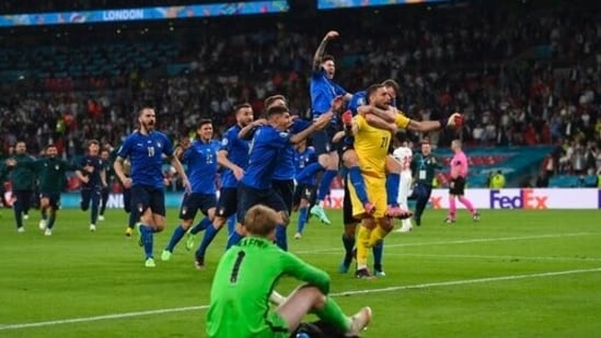 Italian players celebrate after the penalty shootout of the Euro 2020 soccer final match.