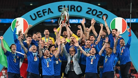 Italian team celebrates with the Euro 2020 trophy after beating England 3-2 on penalties in the Wembley Stadium in London.(Getty Images)