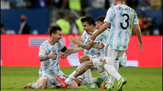 Argentina's Lionel Messi celebrates with teammates after winning the Copa America. (REUTERS)