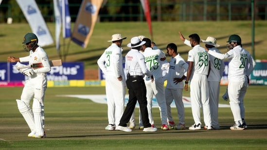 Zimbabwe batsman Milton Shumba,left, walks off the pitch after been dismissed on the second day of the test cricket match between Zimbabwe and Bangladesh at Harare Sports Club in Harare,Thursday, July,8, 2021.(AP Photo/Tsvangirayi Mukwazhi)(AP)