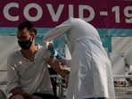 A medical worker administers a shot of Russia's Sputnik V coronavirus vaccine at a vaccination center in Gostinny Dvor, a huge exhibition place in Moscow, Russia.(AP)