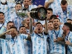 Argentina's Lionel Messi hoists the trophy after beating Brazil 1-0 in the Copa America final.(AP)
