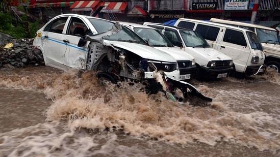 Several vehicles were damaged in a flash flood near Dharamshala, in Kangra district, Himachal Pradesh.(HT Photo)