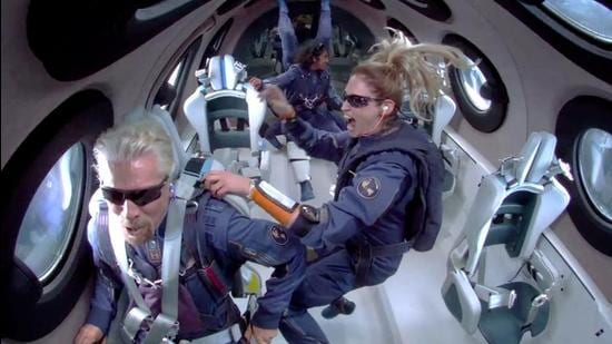Billionaire Richard Branson makes a statement as crew members Beth Moses and Sirisha Bandla float in zero gravity on board Virgin Galactic's passenger rocket plane VSS Unity after reaching the edge of space above Spaceport America near Truth or Consequences, New Mexico, US July 11, 2021. (via REUTERS)