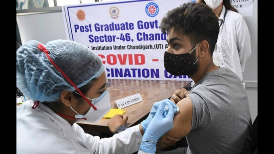 A student getting vaccinated at a special camp for college students and teachers at Post-Graduate Government College in Sector 46, Chandigarh, on Monday. (Keshav Singh/HT)