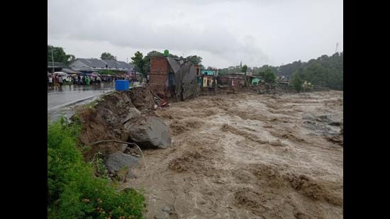 Houses damaged in a flashflood that hit Kangra district after overnight rain on Monday. (HT Photo)