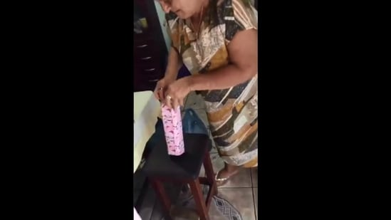 The image shows the grandma opening granddaughter's gift without knowing it is a Barbie.(Screengrab)
