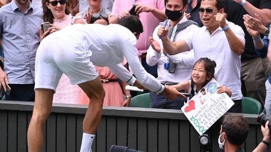Novak Djokovic gives young fan his racquet after Wimbledon win, reacts to viral video on social media.(TWITTER/WIMBLEDON)
