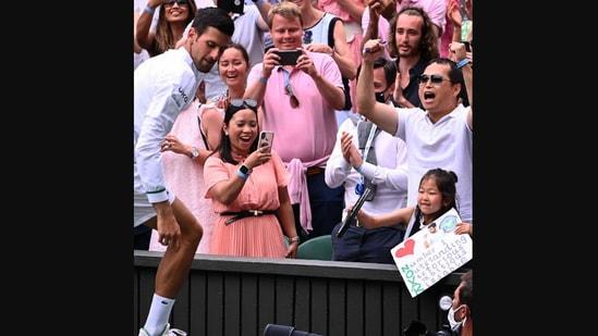 The image shows Novak Djokovic walking away after gifting his racquet to a young fan.(Instagram/@wimbledon)