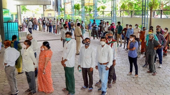 People stand in a queue to receive a dose of Covid-19 vaccine in Bhopal, on Monday.(PTI Photo)