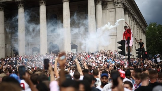 England fans with flares gather in Trafalgar Square ahead of the match(Reuters)