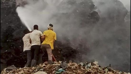 Firefighters are engaged in operations to douse the flames at the landfill. (PTI)