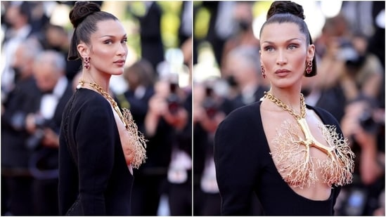 Bella Hadid covers her breasts with gold necklace in deep-cut gown at Cannes(Instagram/@schiaparelli)