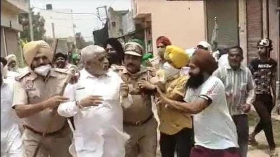 Rajpura BJP councillor Shanti Swarup facing farm protesters even as Punjab Police personnel were escorting him to safety on Sunday afternoon.