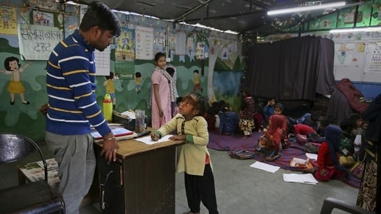 """Though there has been no thorough survey till date, estimates with the WCD department suggest that Delhi, on any given day, has 60,000 to 70,000 children surviving in """"street-like"""" situations.(AP file photo)"""