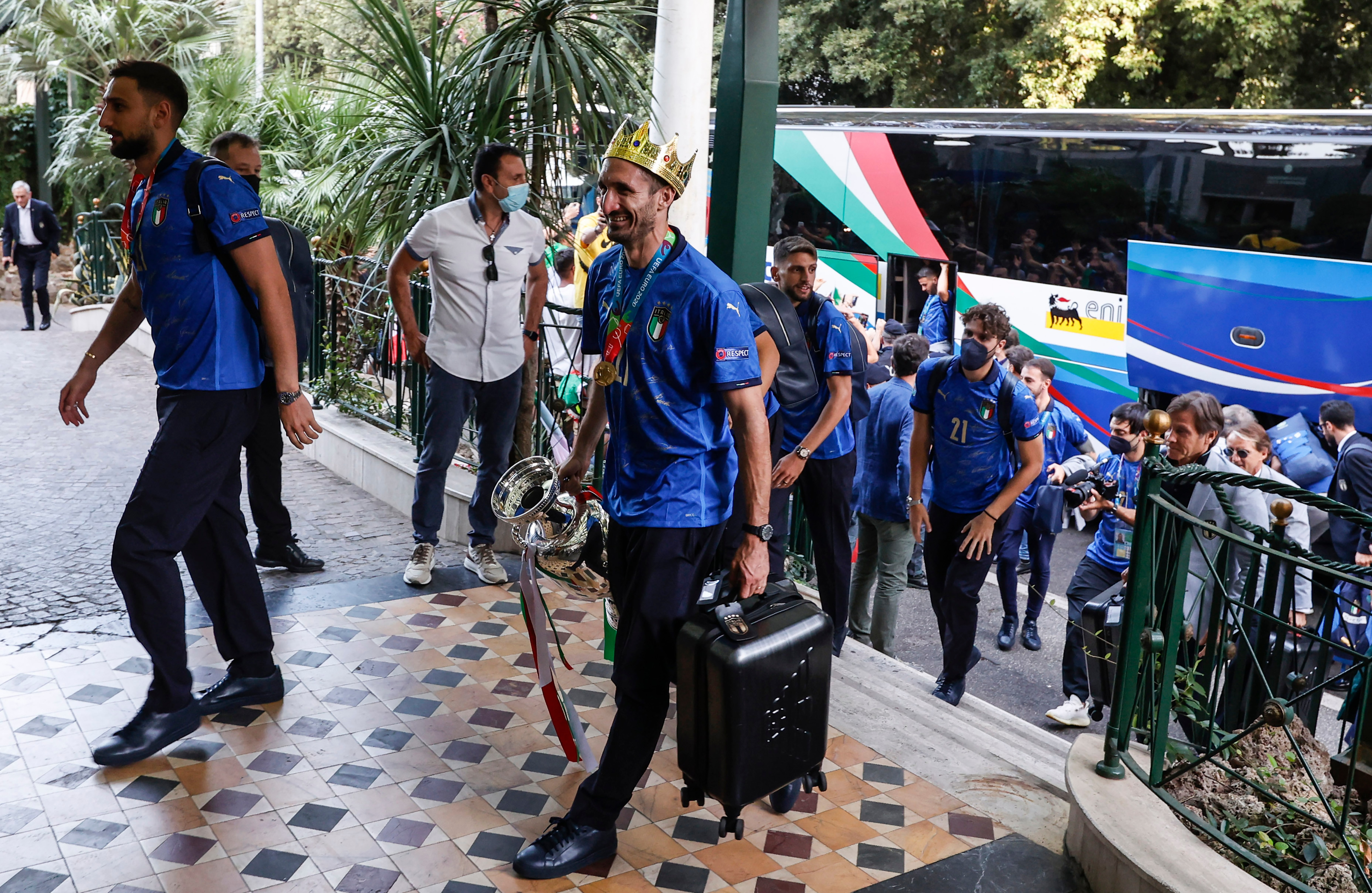 Euro 2020- Italy's captain Giorgio Chiellini, wearing a crown and holding the trophy, and his teammates arrive at a hotel after returning from London, in Rome.(AP)