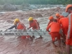 NDRF personnel conducts a search and rescue operation search in the wake of the Himachal Pradesh flash flood, on Monday. (ANI Photo)