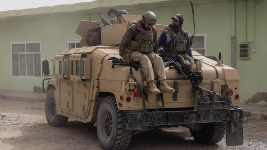 Members of Afghan Special Forces climb down from a humvee as they arrive at their base after heavy clashes with Taliban during the rescue mission of a police officer besieged at a check post, in Kandahar province, Afghanistan.(REUTERS)