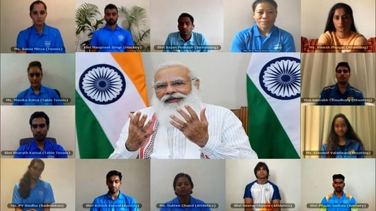 Prime Minister Narendra Modi interacts with the Indian athletes contingent bound for Tokyo Olympics, through video conferencing, in New Delhi. (ANI Photo)