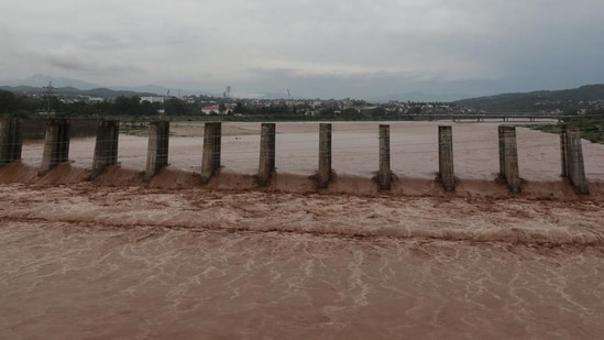 A view of the flooded Tawi river after heavy rain in Jammu on Monday. (PTI)