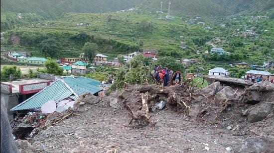 Rescue work is on to locate the nine people who went missing after the landslide at Rulehar village of Boh panchayat in Shahpur division of Kangra district on Monday. (HT Photo)