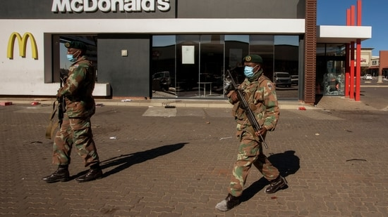 Soldiers patrol at a shopping centre in Soweto, Johannesburg, Tuesday July 13, 2021. (AP)