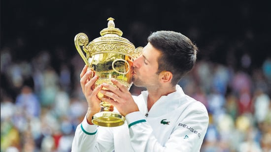 Novak Djokovic with the Wimbledon trophy after winning his final match against Italy's Matteo Berrettini on Sunday, July 11. (File photo)