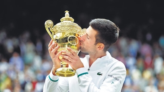 Novak Djokovic with the Wimbledon trophy after winning his final match against Italy's Matteo Berrettini.(File photo)