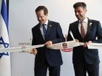 Israel's President Isaac Herzog, left, cuts a ribbon with United Arab Emirates Ambassador to Israel Mohamed Al Khaja during the opening ceremony for the new UAE Embassy in Tel Aviv, Israel.(AP)