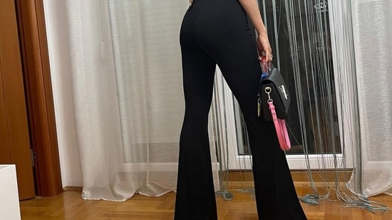 Natasa paired this with flared black pants that had tie up and ring detailing at the top from high street fashion brand Bershka and priced at <span class=