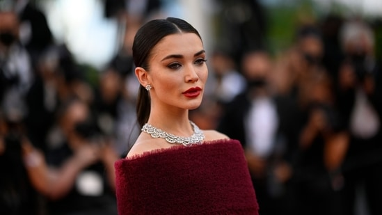 """British actress and model Amy Jackson arrives for the screening of the film """"A Felesegem Tortenete"""" (The Story Of My Wife) at the 74th edition of the Cannes Film Festival in Cannes, southern France, on July 14, 2021. (AFP)"""