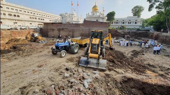 The structures were excavated while digging the soil for building a new jora ghar at the Golden Temple Complex in Amritsar. (HT Photo)