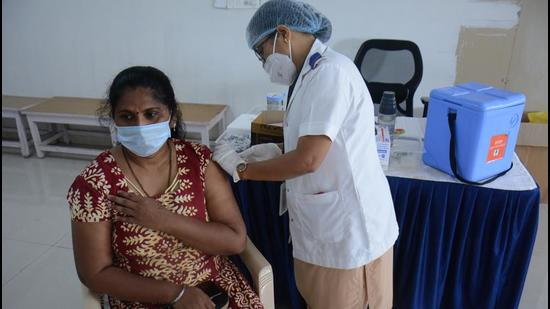 A beneficiary gets vaccinated at a Post Covid Vaccination Centre in Thane, Mumbai on Thursday, July 15. (Praful Gangurde / HT photo)