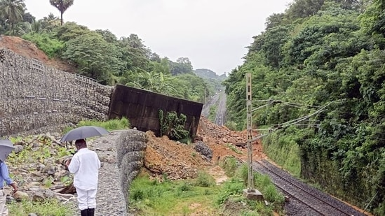 The landslide triggered by heavy rains brought down a portion of the retaining wall too thereby blocking the track.(ANI)