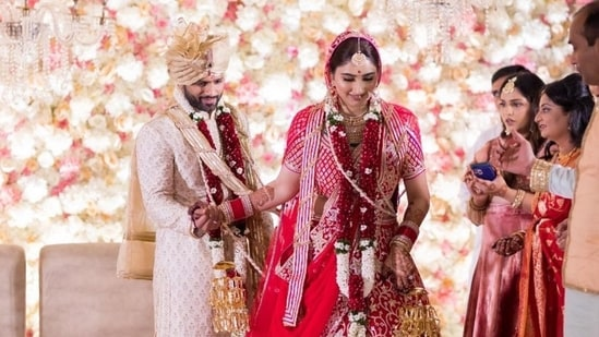 Disha Parmar's stunning lehenga was from the Dancing Peacock collection of ace designer duo Abu Jani and Sandeep Khosla and Rahul Vaidya was also wearing a piece from the designer's original collection.  (Instagram/IsraniPhotography)