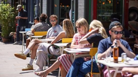 People dine outdoors at Broadway Market in Hackney, London, UK.(Bloomberg)