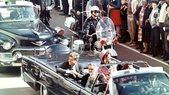 John F Kennedy had been adviced by his security staff against travelling in an open motorcar.