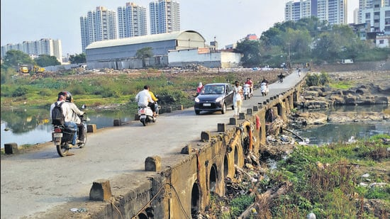 Bad condition of a bridge on Mutha river near Nanded village-Shivne. PMC votes to prepare DP for merged villages. (HT)