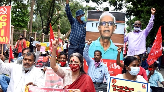 CPI (M) leader Brinda Karat with others holding placards shout slogans during a protest demanding justice for Father Stan Swamy near Raj Bhavan, in Ranchi on Thursday. (ANI Photo)