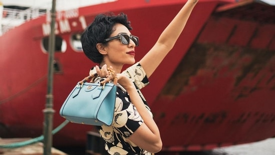 With this Sobhita paired a light blue leather Gucci Diana mini tote bag, which according to the website has the signature bamboo handles and Double G hardware, accentuated by two neon bands.(Instagram)