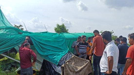 People gather at the crash site