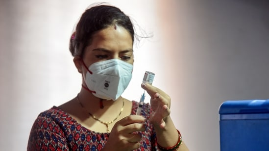 A healthcare worker fills a syringe with a dose of Covid-19 vaccine at a vaccination centre, in New Delhi on Saturday. (ANI Photo)