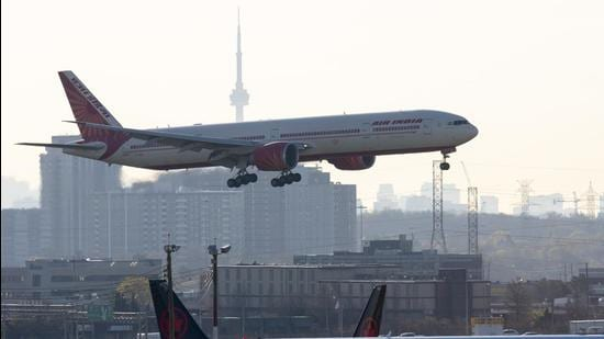 Air India flight 187 from New Delhi lands at Pearson Airport in Toronto on April 23, 2021. (AP)